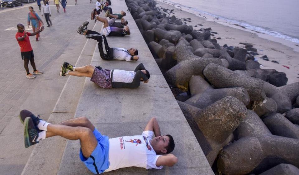 People prepare for the Mumbai Marathon at Marine Drive.
