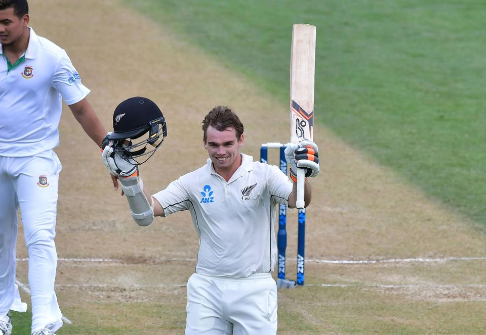 New Zealand cricket team's Tom Latham celebrate after scoring a century against Bangladesh cricket team in the 1st Test at the Basin Reserve in Wellington on Saturday. Mushfiqur Rahim (159) and Shakib Al Hasan (217) batted New Zealand out of the Test with a record partnership of 359 runs for the fifth wicket on Friday.