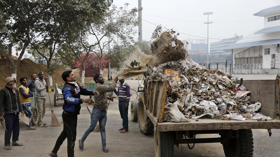 Garbage being collected by the workers at Sector 7 on Saturday. The resident's body of Sushant Lok 1 will organise an awareness camp on Sunday and more than 200 rag pickers and garbage collectors will be trained in employing safety first technique while picking waste.