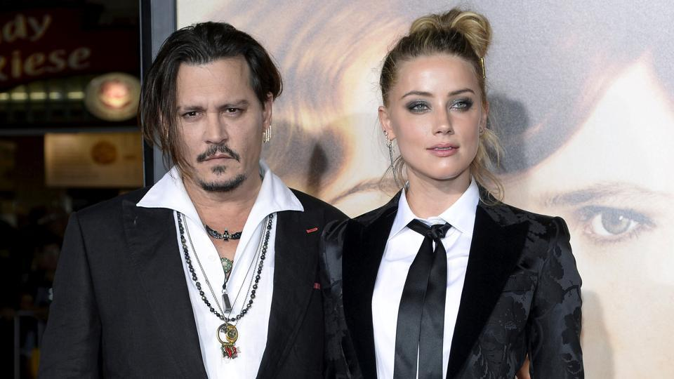 (File) Johnny Depp and Amber Heard have both made claims and counter claims throughout their divorce proceedings with Heard accusing Depp of domestic violence and he of financial blackmail.
