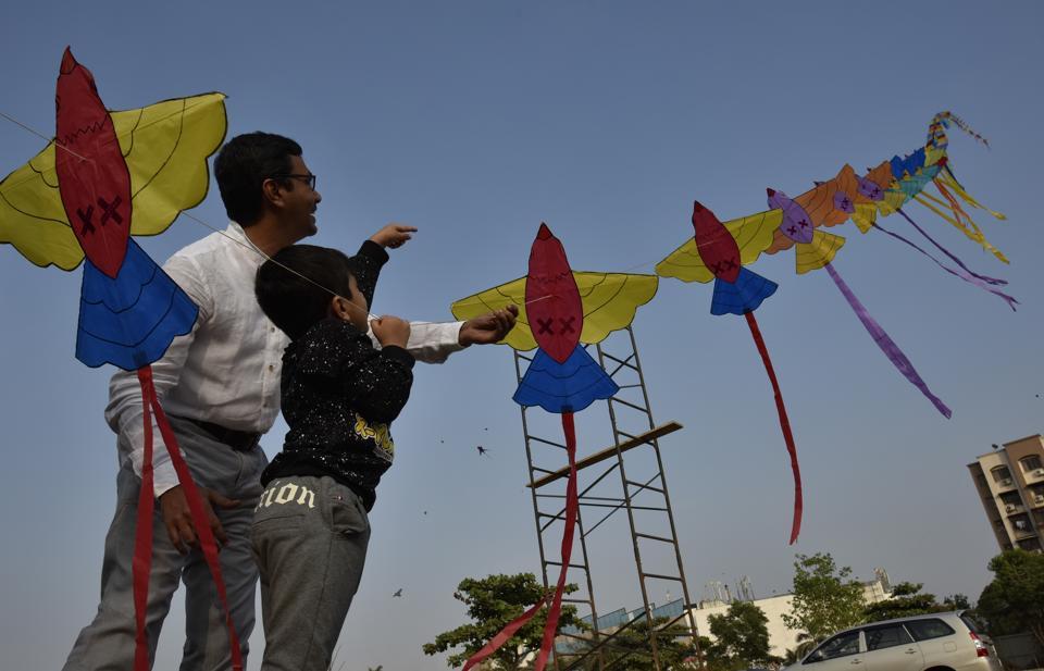 Jash and his father fly kites  to celebrate  Makar Sankranti near Bhakti Park in Mumbai. (Arijit Sen/HT PHOTO)