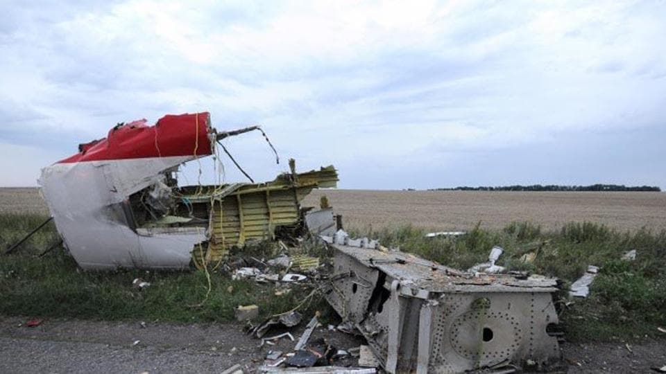 A picture taken on July 17, 2014 shows the wreckages of the malaysian airliner carrying 295 people from Amsterdam to Kuala Lumpur after it crashed, near the town of Shaktarsk, in rebel-held east Ukraine.