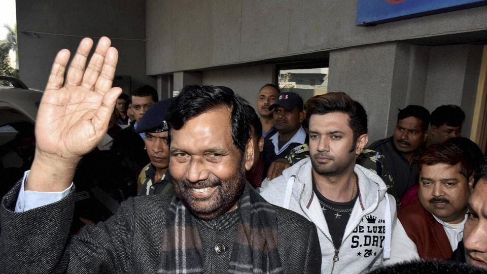 Union Minister and Lok Janshakti Party (LJP) president Ram Vilas Paswan waves to supporters after he being discharged from a private hospital where he was admitted after complaining of breathlessness, in Patna on Saturday.