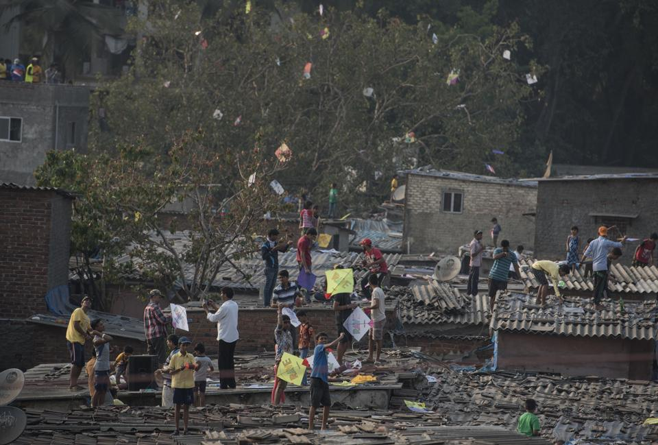 People fly kites from the roofs of their  houses at Santacruz in Mumbai. (Satish Bate/HT PHOTO)