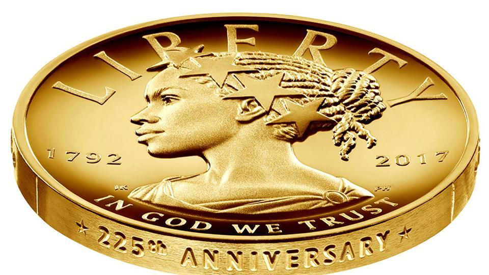 The new $100 gold coin featuring an African-American woman as the face of Lady Liberty for the first time in the history of US currency, is shown in this photo in Washington, DC, provided January 13.