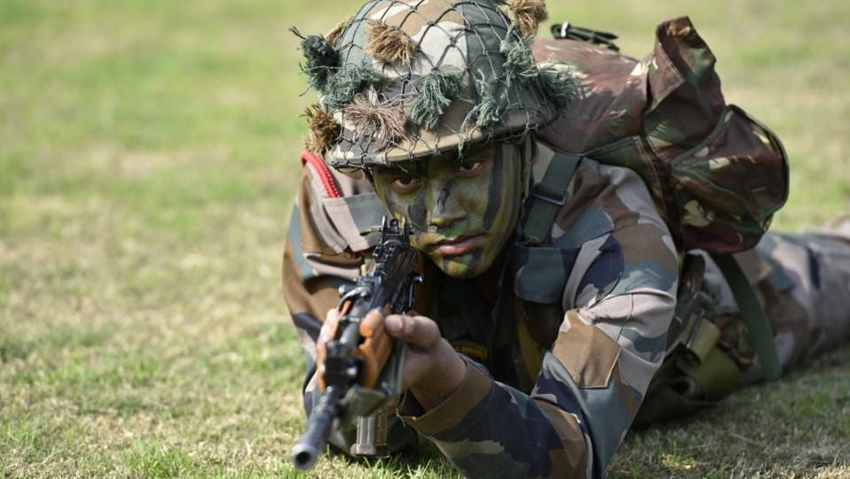 Army soldiers display their war skills during the Army Day parade at Delhi Cantt in New Delhi on Sunday.  (Arvind Yadav/HT PHOTO)