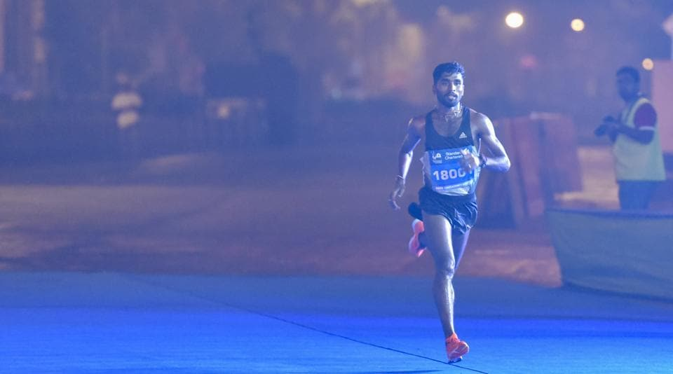 Lakshmanan G won the half marathon.  (kunal patil/ht photo)