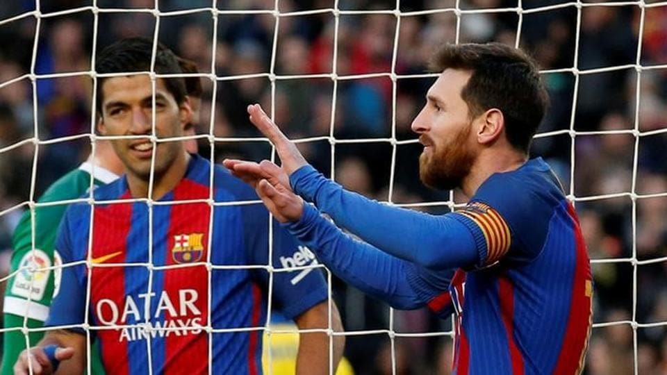 FC Barcelona's Lionel Messi and Luis Suarez celebrate after scoring against Las Palmas, who they beat 5-0. The win has pushed Barca to second place, just two points behind Real Madrid C.F.