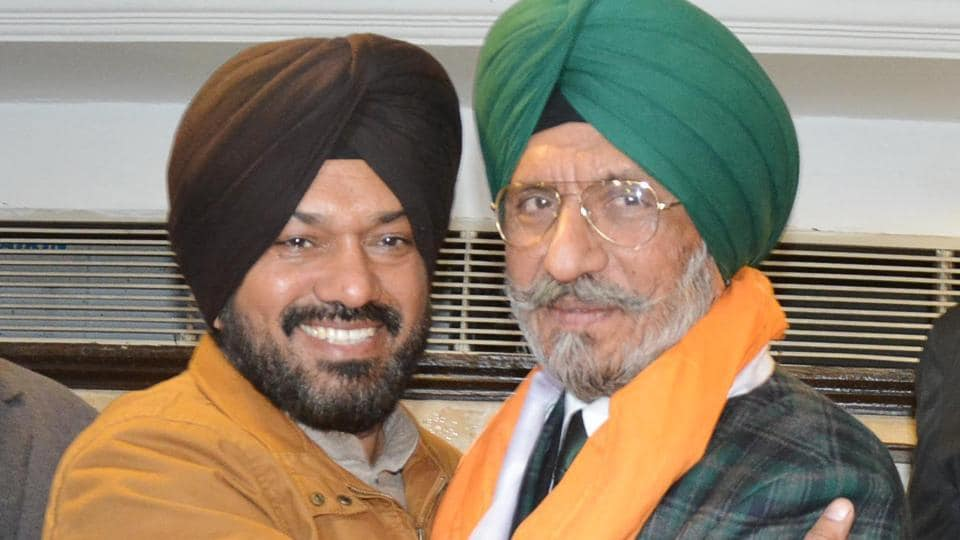Upkar Singh Sandhu (right) with AAP's Gurpreet Singh Waraich during a press conference in Amritsar on Saturday.