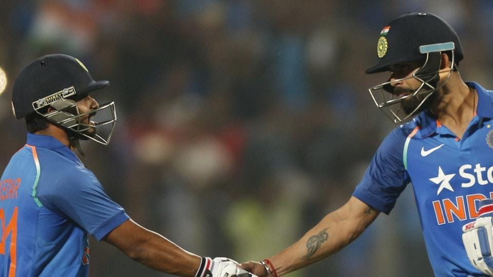 Virat Kohli and Kedar Jadhav smashed centuries as India chased down 350 to take a 1-0 lead in the series.