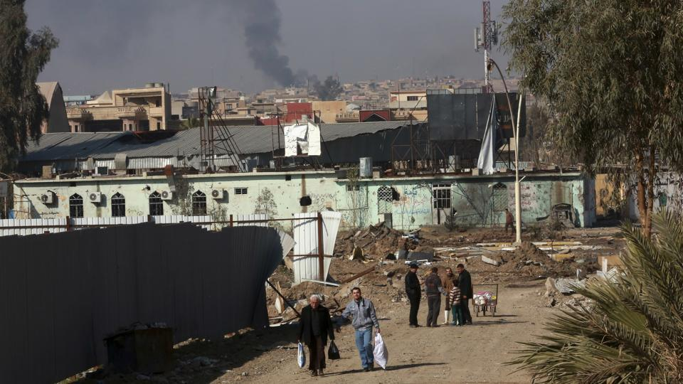 Civilians leave their homes as Iraqi security forces continue the fight against Islamic State militants to regain control of the city of Mosul.