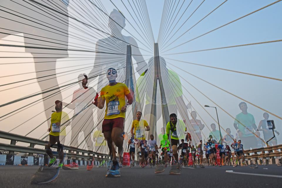 In camera double exposure shot of participants run during the 2017 Mumbai Marathon at Bandra-worli Sealink. (Pratik Chorge/HT PHOTO)