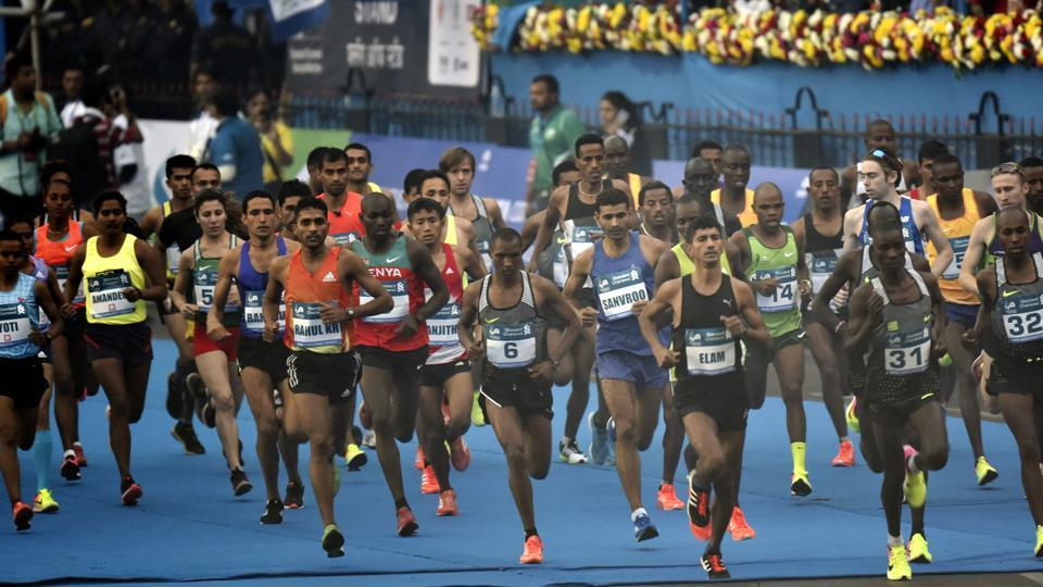 Elite Athletes at the starting point  of the full marathon at CST in Mumbai. (Anshuman Poyrekar/HT PHOTO)