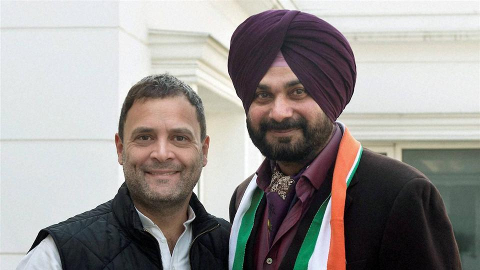 Congress Vice-President Rahul Gandhi welcomes former BJP leader Navjot Singh Sidhu into the party at his residence in New Delhi on Sunday.