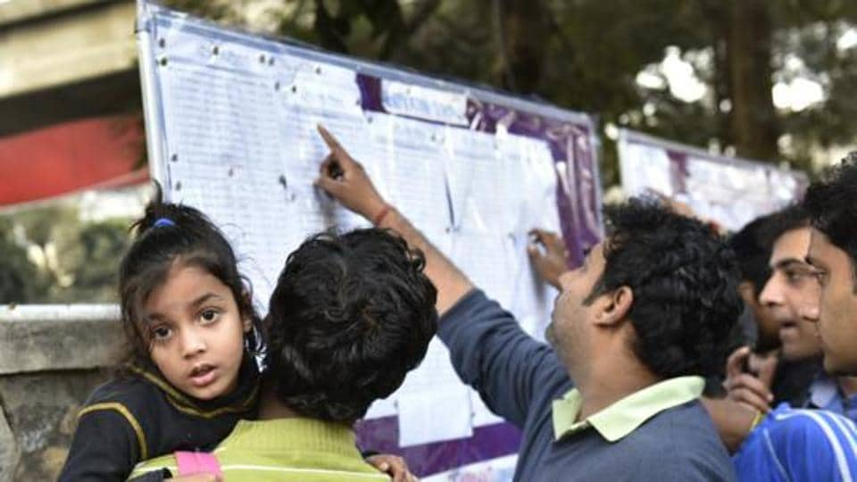 New Delhi, India - Feb. 15, 2016: Parents looks list of selected children for nursery class admission at Bal Bharati public school near Gangaram Hospital marg in New Delhi, India, on Monday, February 15, 2016. (Photo by Arvind Yadav/ Hindustan Times)