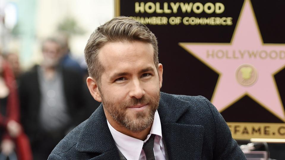 In this December 2016 file photo, actor Ryan Reynolds poses at a ceremony honouring him with a star on the Hollywood Walk of Fame in Los Angeles. Reynolds has been named Man of the Year by Harvard University's Hasty Pudding student theatrical group. The actor who played the title role in 2016's Deadpool will be roasted by the student group before getting his pudding pot .