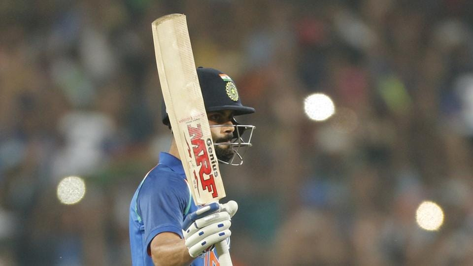 India national cricket team captain Virat Kohli celebrates his century in the first ODI against England in Pune on Sunday. He surpassed Sachin Tendulkar's record of 14 centuries in successful chases.