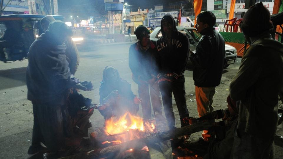 People warming themselves around a fire to beat the cold in Ranchi on January 13.