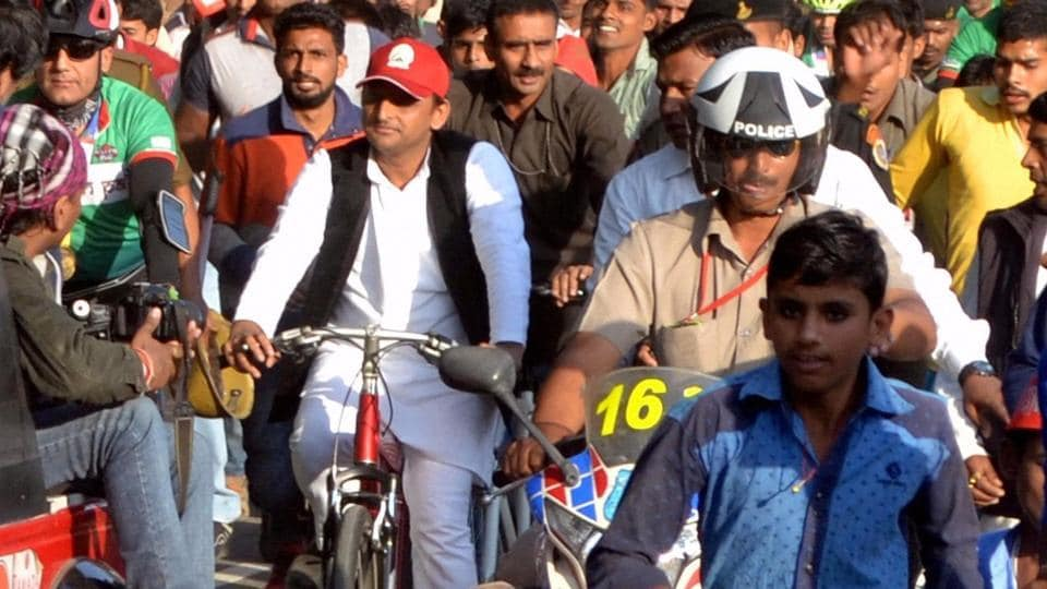 UP chief minister Akhilesh Yadav rides a bicycle after opening the Inner Ring Road, near Agra. In a morale booster, he was allotted the SP's bicycle symbol by the Election Commission on Monday.