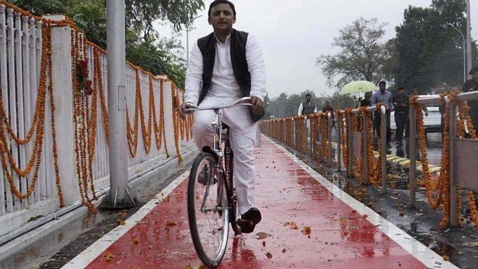 Akhilesh rides on the cycle as Election Commission grants 'cycle symbol' to him.