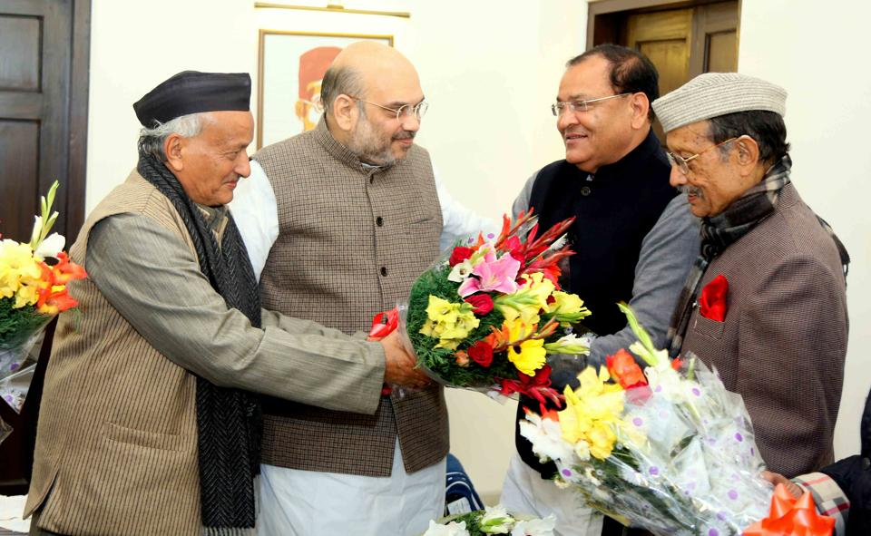 BJP president Amit Shah and former chief minister BS Koshyari welcome Yashpal Arya (second from right) to the party in New Delhi on Monday.