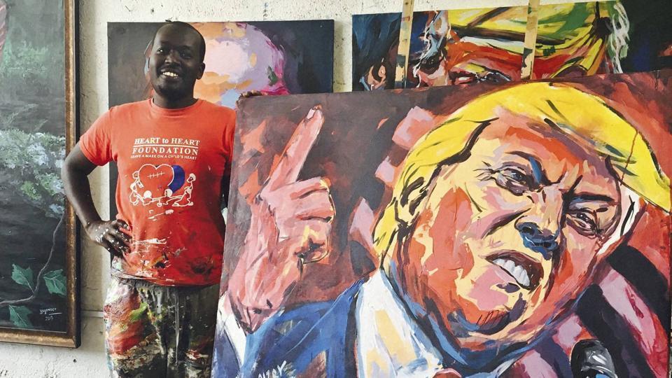 Kenyan artist Evans Yegon displays one of his paintings of Donald Trump.