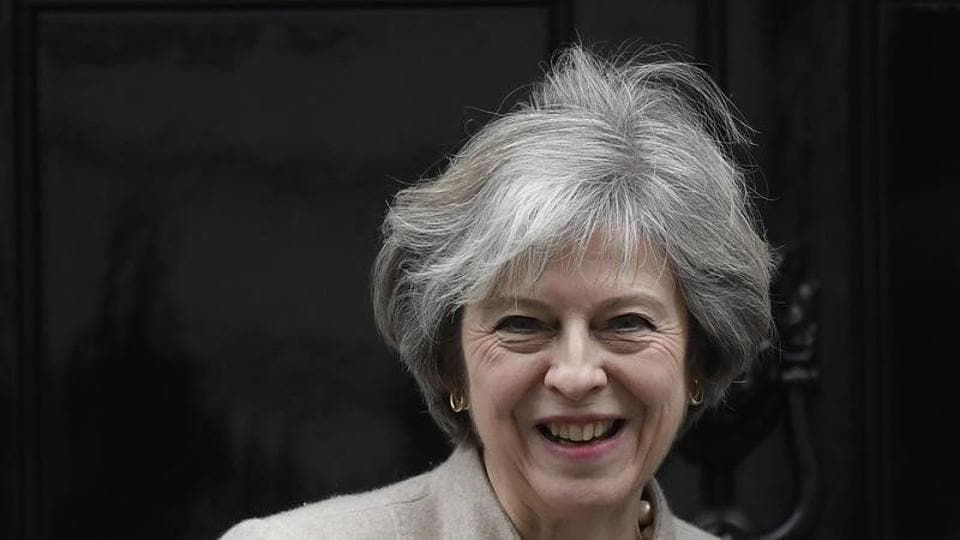 File photo of British Prime Minister Theresa May waiting to greet her New Zealand counterpart Bill English at Number 10 Downing Street in London on January 13, 2017.