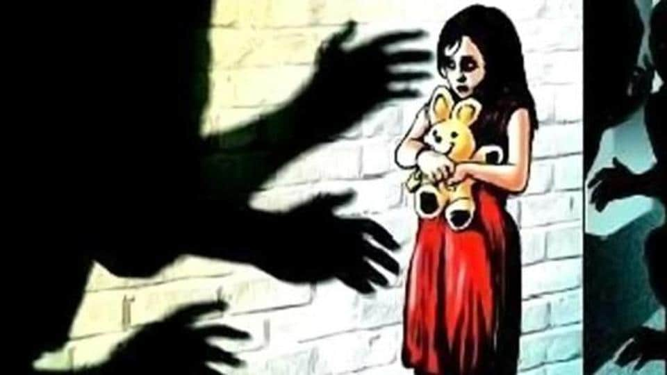 The victim's father complained to the police that someone lured his daughter by offering her sweets and raped her