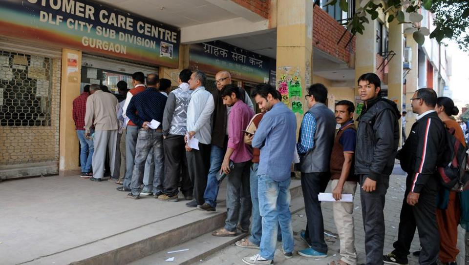 Electricity consumers queue up to pay their bills at the costumer care centre at Sector 31.