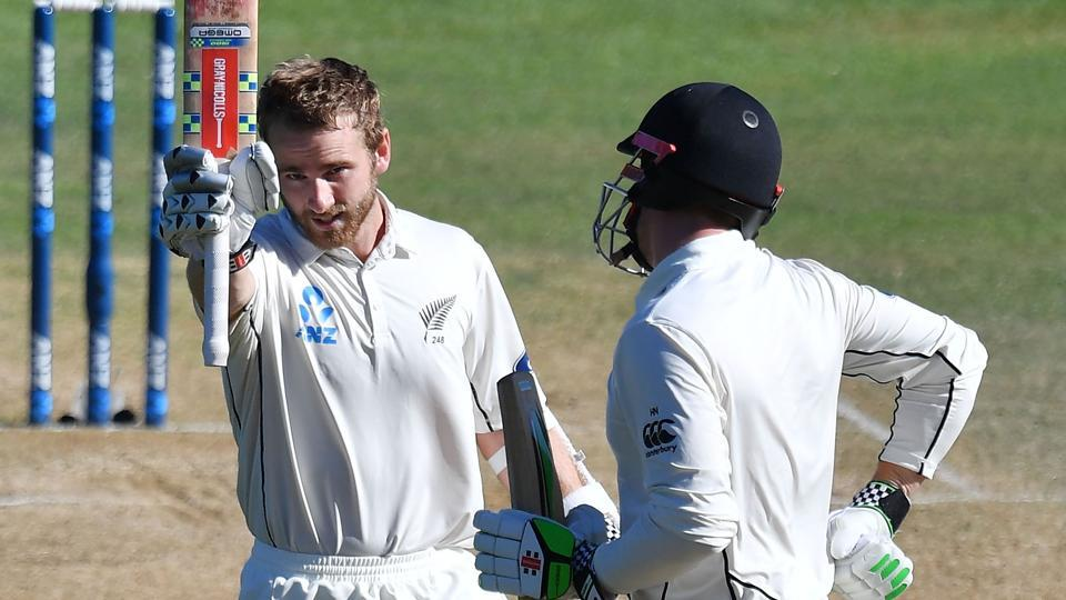 New Zealand's captain Kane Williamson celebrates 100 runs with teammate Henry Nicholls during day five of the first Test against Bangladesh at the Basin Reserve in Wellington on Monday.