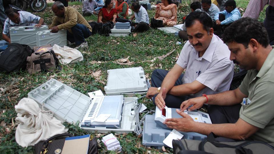 Staffers check EVMs, in Dehradun, Uttarakhand.