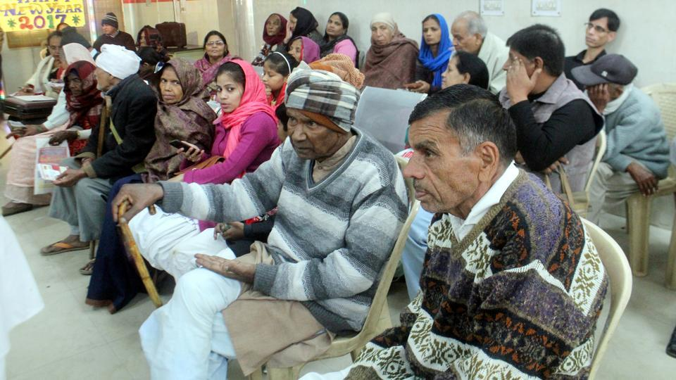 Senior citizens waiting to get their pensions, delayed after the note ban decision, at the post office at Sadar Bazar in Gurgaon