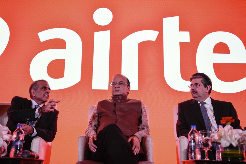 Founder and Chairman of Bharti Enterprises, Sunil Bharti Mittal,(L), Union Finance Minister, Arun Jaitley (C) and vice chairman and managing director of Kotak Mahindra Bank, Uday Kotak look on during the launch of Airtel payment banks.