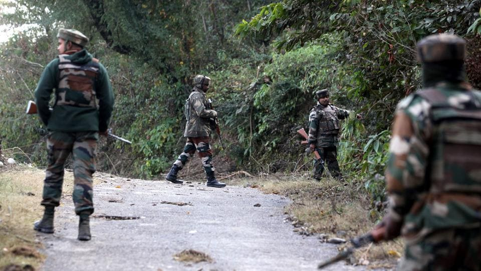 Indian army soldiers take position during an encounter with suspected militants in the village of Batal in Akhnoor District, some 50kms north of Jammu, on January 9.