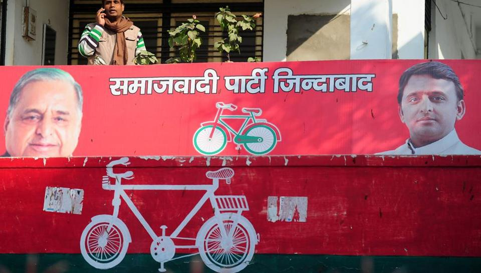 A party worker of India's Samajwadi Party stands on the balcony of a Samajwadi Party office adorned by the present party symbol a bicycle in Allahabad.