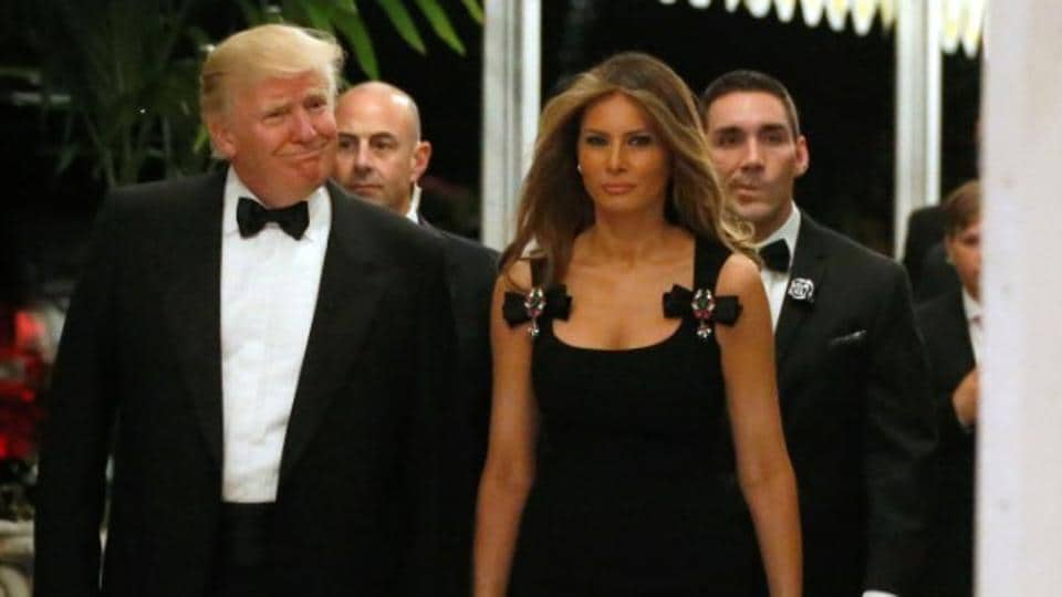 Melania Trump wearing a Dolce & Gabbana dress with her husband, President-elect Donald Trump, at a New Year's Eve party at his Mar-a-Lago estate in Palm Beach, Florida on Dec 31, 2016.