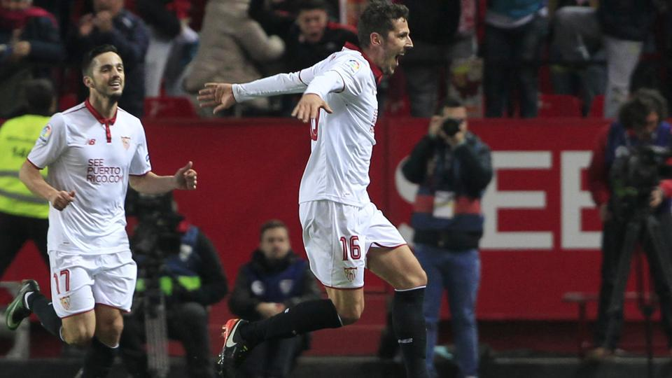 Sevilla's Stevan Jovetic (right)celebrates after scoring the late-winner against Real Madrid C.F. in their La Liga match at the Ramon Sanchez Pizjuan stadium,  onSunday. Cristiano Ronaldo's penalty put Madrid in front, but Sergio Ramos's own goal levelled before Jovetic curled home from 25 yards.