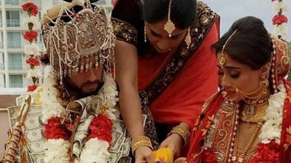 Somya wore a seemingly heavy, traditional red lehenga for her big day and her groom was in a dark sherwani.