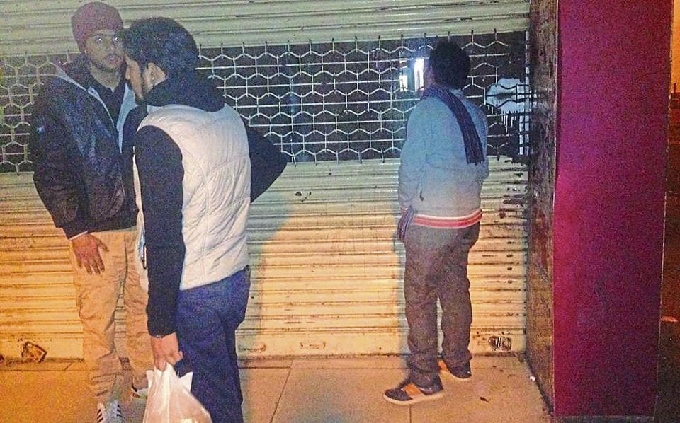 People buying liquor from a shop after it was closed at Sector 22, Chandigarh, on Tuesday.