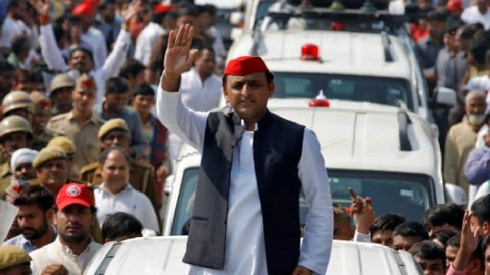 Akhilesh Yadav, chief minister of Uttar Pradesh  waves at his supporters during a Rath Yatra, as part of an election campaign in Lucknow.