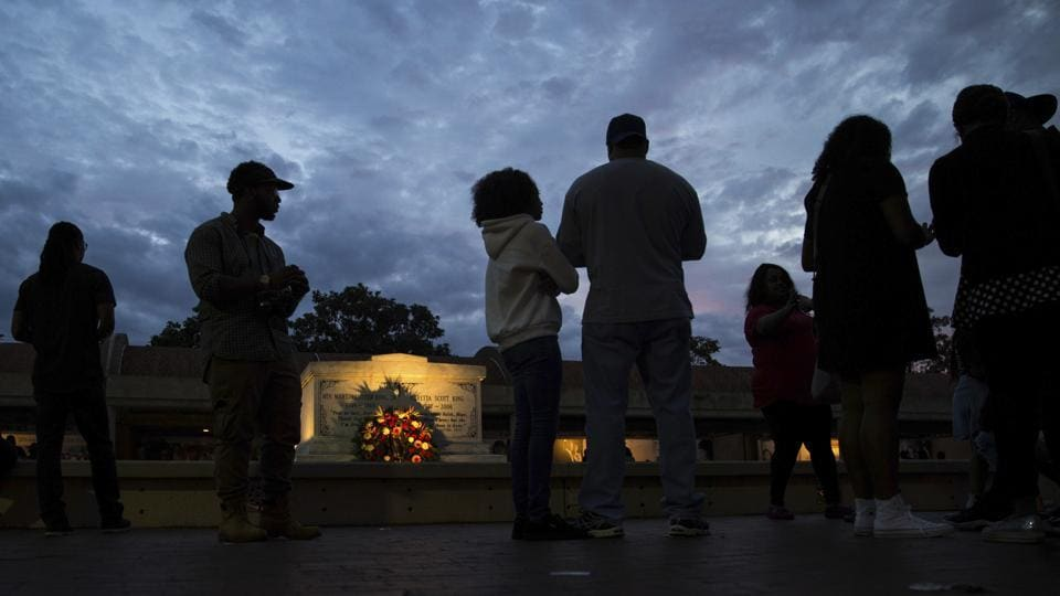 People visit the tomb of the Rev. Martin Luther King Jr. and his wife Coretta Scott King. (Branden Camp/AP)