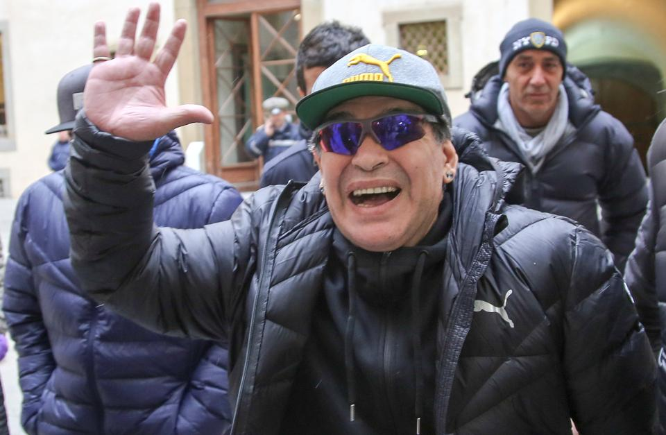 Argentina football legend Diego Maradona waves as he arrives to take part at the Italian Hall of Fame 2017 event in Florence on Tuesday. (REUTERS)