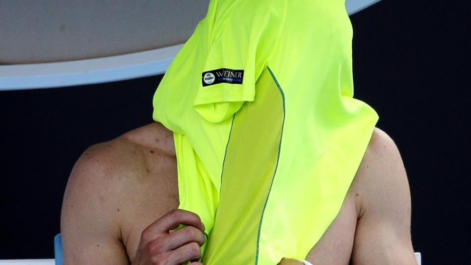 Change (of shirts) was the order of the day in the first round match between Germany's Jan-Lennard Struff and Austria's Dominic Thiem at the Australian Open .  (AP)