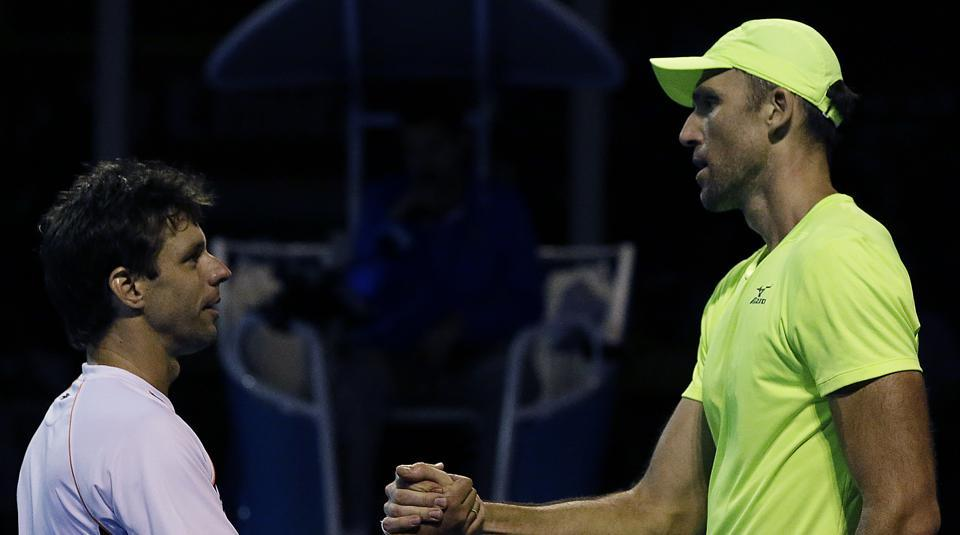 Ivo Karlovic (right) is congratulated by Horacio Zeballos after their  Australian Open Rd 1 match.