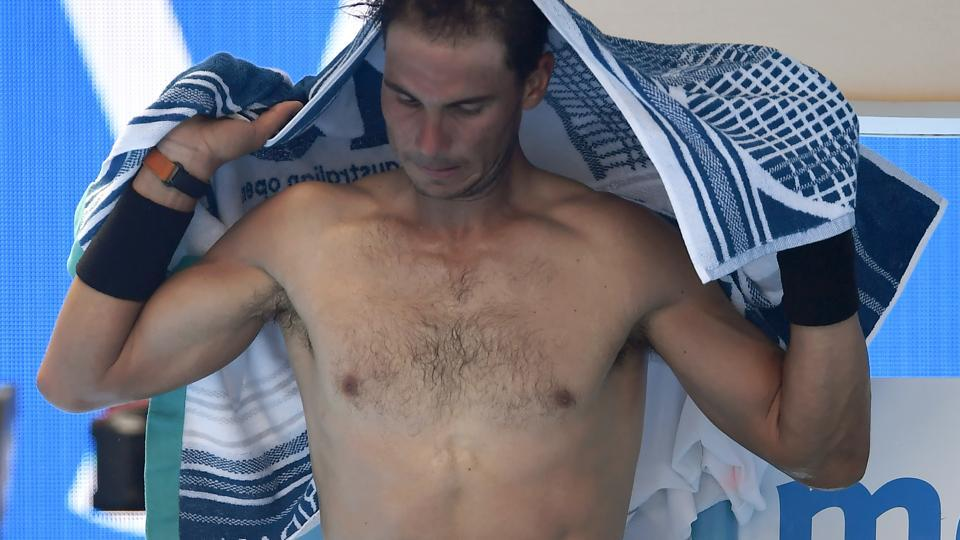 Spain's Rafael Nadal's fitness looked to be back to its best during his Australian Open first-round match against Germany's Florian Mayer on Sunday. He won in straight sets but heat forced him to change shirts a couple of times during the match.  (AP)
