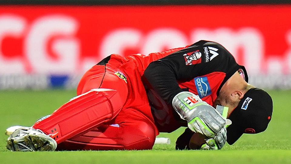 Peter Nevill of the Melbourne Renegades got injured after getting struck in the head by the bat of Brad Hodge during the Big Bash League match against Adelaide Strikers on Monday.