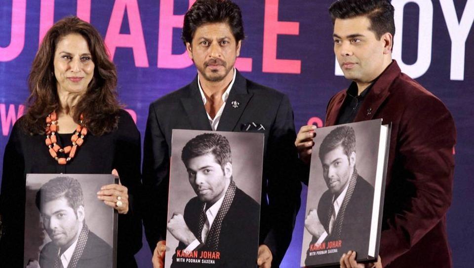 Columnist Shobhaa De, actor Shah Rukh Khan and Bollywood filmmaker Karan Johar during the launch of Karan's biography An Unsuitable Boy', co-authored by Poonam Saxena in Mumbai.