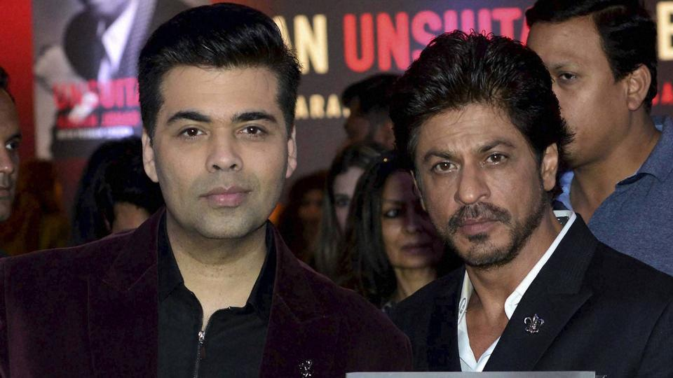 Mumbai : Bollywood actor Shahrukh Khan, filmmaker Karan Johar during a book launch of An Unsuitable Boy by Karan Johar, in Mumbai on Monday. PTI Photo (PTI1_16_2017_000228B)