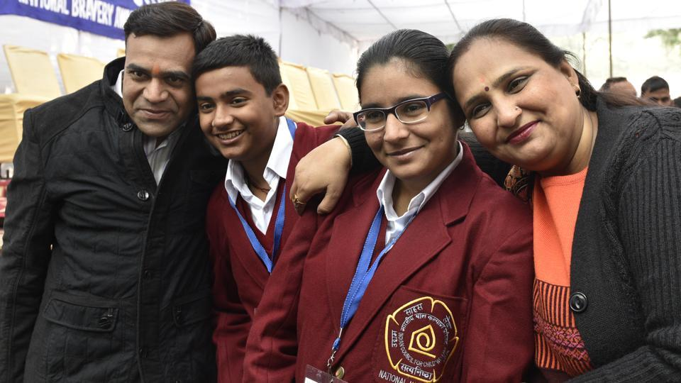 Akshita and her brother Akshit Sharma from Delhi, with their parents, won the National Bravery Award for apprehending thieves who had broken into their home. (Mohd Zakir/HT Photo)