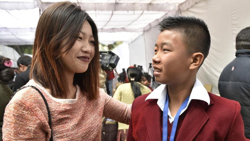 Fourteen-year-old Moirangthem Sadananda Singh at the function with his sister. He won an award for saving his mother from electrocution at home. (Mohd Zakir/HT Photo)
